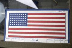 American flag on the windshield of a military vehicle Royalty Free Stock Photography