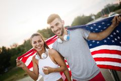 American flag - woman and man USA sport athlete winner cheering waving US flag stock photos