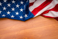 American flag on wood background. Stock Images