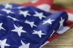 American flag on wood background stock image