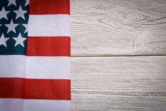 American flag on a wooden background. The concept of freedom and patriotism.  stock photo