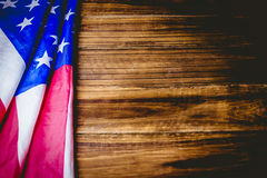 American flag on wooden table Stock Images