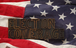 American flag with the words election coverage. Election coverage words in old wood type on a USA flag Stock Image