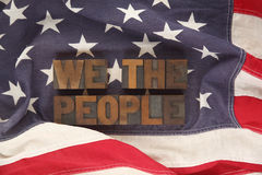 American flag with words we the people. First words of the Preamble to the Constitution on an old flag Stock Images