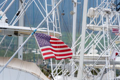 American flag in yacht mast. American flag in harbor in wind Stock Photos