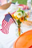 American Flag and Zinnia. Image of an American Flag in a case with garden flowers Royalty Free Stock Photos