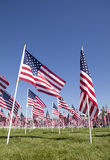 American Flags. View of a patriotic flag display from the ground looking up with copy space above the flags Stock Photo