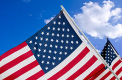 American flags against sky Stock Photo