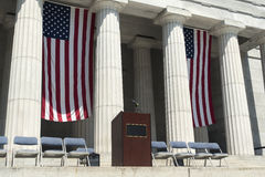 American flags behind podium Stock Image