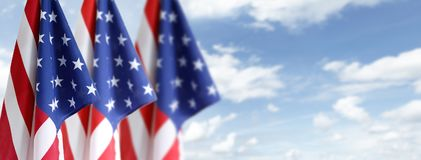 American flags. In blue sky stock photography