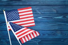 American flags. On blue wooden table stock photography
