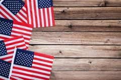 American flags. On brown wooden table stock photos