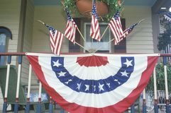 American Flags and bunting Hung on Porch of House Stock Photography