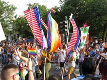 American Flags at the Capital Pride Parade in Washington DC. Photo of marchers and american flags at the capital pride parade in washington dc on 6/9/18. This stock photos