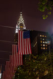 American flags and Chrysler building in background Stock Photos