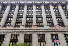 American Flags and Columns on Chicago Building Royalty Free Stock Photography