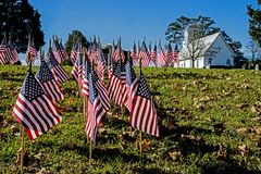 Free American Flags Cover The Ground Near A Little White Church. Royalty Free Stock Images - 142461929
