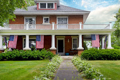 American flags decoration old brick home Royalty Free Stock Photography