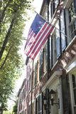 American flags displayed on historic 18th century home in Alexandria, VA Stock Photo