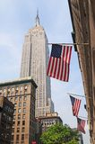 American flags and empire state background. American flags and empire state building background royalty free stock photography