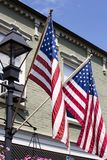 American flags flying in Old Town Warrenton Virginia. American flags flying by a lamp post in Old Town Warrenton Virginia Stock Photography