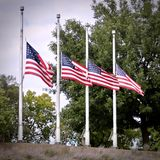 4 American flags at half-mast royalty free stock photos