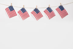 American flags hanging on clothesline on white background. American flags hanging on clothesline isolated on white background stock photography