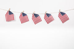 American flags hanging on clothesline on white background. American flags hanging on clothesline isolated on white background stock images
