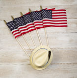 American Flags and Hat with feather on faded white wooden boards Royalty Free Stock Images