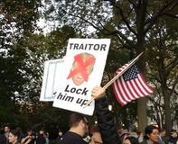 American Flags, Lock Him Up! Traitor, Rally Against Trump, Washington Square Park, NYC, NY, USA. It`s almost one year after the historic election of Donald Trump Royalty Free Stock Images