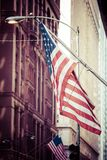 American flags outside a building Stock Photo