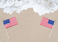 American flags on the sandy beach Stock Images