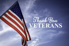 American flags with a Veterans Day greeting. With blue sky baacakground royalty free stock photography