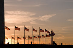 American flags at Washington Monument. American flags around Washington Monument at sunset, under dramatic sky Stock Images