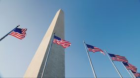 American flags and the Washington Monument. Washington Monument in the heart of the city. Washington, District of Columbia. 4K video stock footage
