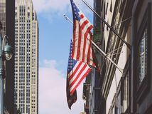 American flags waving from a building in Manhattan Royalty Free Stock Photos