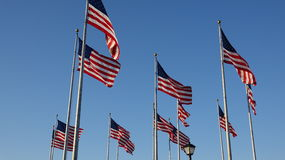 American Flags Waving On Flagpoles. Stock photography in high definition Stock Photography