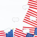 American flags on white background top view. Creative top view flat lay of American flags for Elections, Memorial Day, 4th of July or Labour Day with copy space royalty free stock images