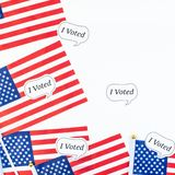 American flags on white background top view. Creative top view flat lay of American flags for Elections stickers I voted with copy space on white background in royalty free stock image