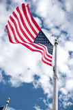 American flags winding on the blue sky Stock Photography