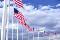 American flags winding on the blue sky Royalty Free Stock Photography