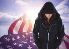 American Flags with woman in black hood Royalty Free Stock Photography