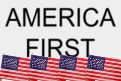 USA. American flags with the words America First Stock Image