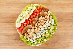 American food Cobb Salad. Traditional American food Cobb Salad - Colorful entree salad with bacon, chicken, eggs and tomatoes stock photo