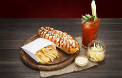 American food - hot dog, bloody mary with potato chips Royalty Free Stock Images
