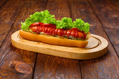 American food - hot dog with tomatoes Stock Photography