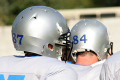 American football. Two players with helmets Stock Image