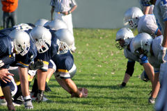 American football. Football players, offense – defense in action Royalty Free Stock Photos