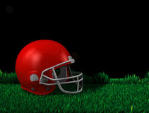 American football. 3d rendering, American football helmet over green field on black background Royalty Free Stock Image