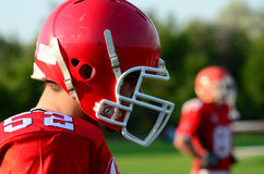 American football. Player wearing red helmet Stock Image